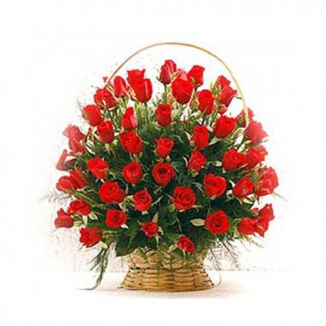 Basket with red roses and greenery